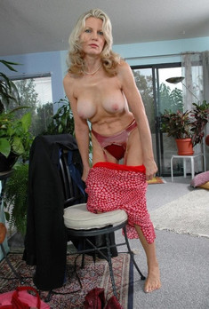 One dissolute mature woman undressing..