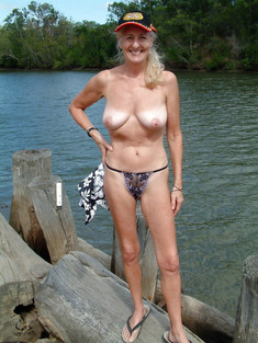 Amateur women posing topless and one..